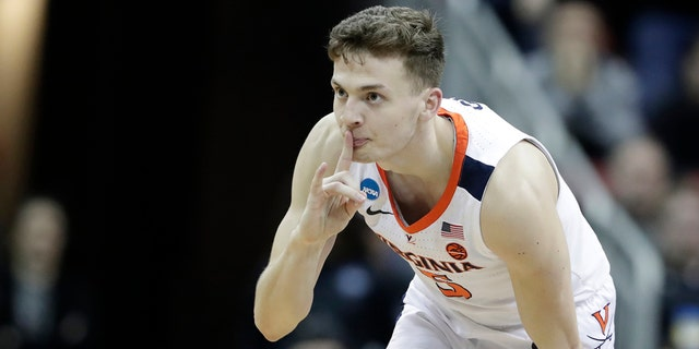 Virginia's Kyle Guy reacts during the second half of the men's NCAA Tournament college basketball South Regional final game against Purdue, Saturday, March 30, 2019, in Louisville, Ky.