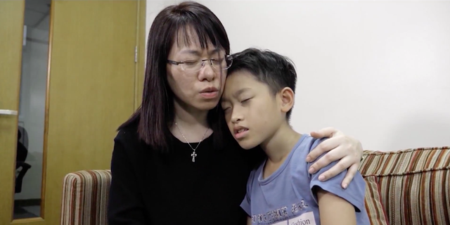 Ngocanh Le prays with her son, Minh Viet. She turned to God after found out he wanted to commit suicide amid being addicted to violent video games.