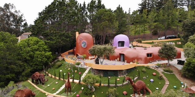 The San Francisco Bay Area suburb of Hillsborough is suing the owner of the so-called Flintstone House, saying that she installed dangerous steps, dinosaurs and other Flintstone-era figurines without necessary permits.