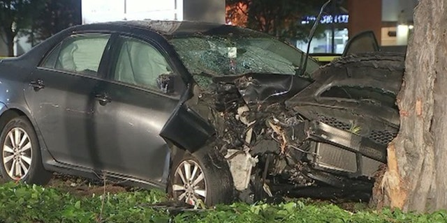 The damaged car can be seen after ramming into 8 people on the sidewalk in Sunnyvale, California on Tuesday.