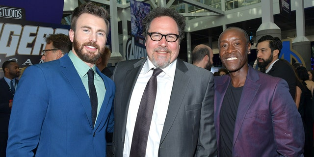 """(L-R) Chris Evans, Jon Favreau and Don Cheadle attend the world premiere of """"Avengers: Endgame"""" at the Los Angeles Convention Center on April 22, 2019 in Los Angeles, Calif."""