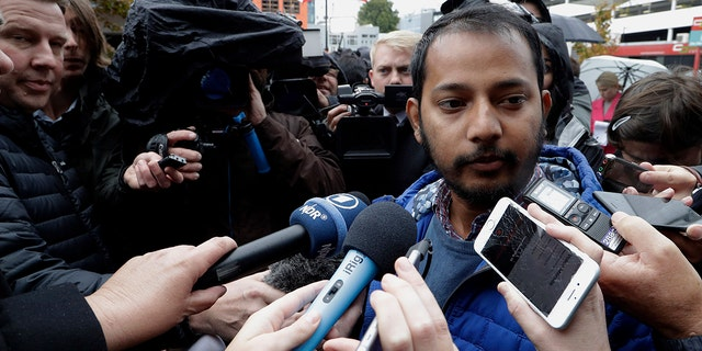 Tofazzal Alam, a survivor of the Linwood Mosque shootings, speaks to the media outside the High Court in Christchurch, New Zealand on Friday. (Associated Press)