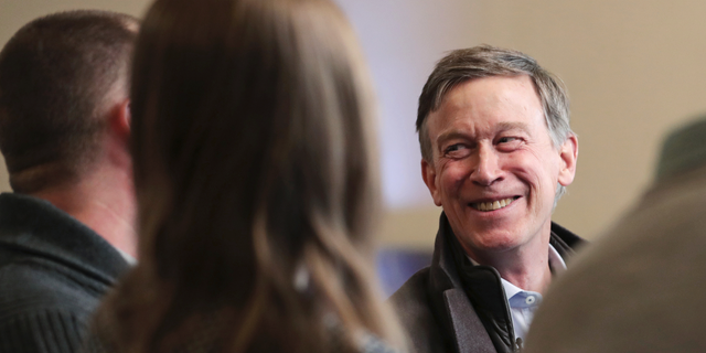 Former Democratic Colorado Governor John Hickenlooper smiles during a meeting with AmeriCorps members at a roundtable campaign stop in Manchester, N.H., Friday, March 22, 2019. Hickenlooper joined the 2020 Presidential race earlier in the month. (AP Photo/Charles Krupa)