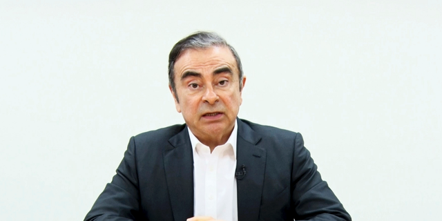 In this image made from video released by Carlos Ghosn via his lawyer Tuesday, April 9, 2019, former Nissan chairman Ghosn speaks on camera in Tokyo. Ghosn, who was arrested in Japan on financial misconduct charges, gets his say in a video shown by his legal team. (Carlos Ghosn via AP)