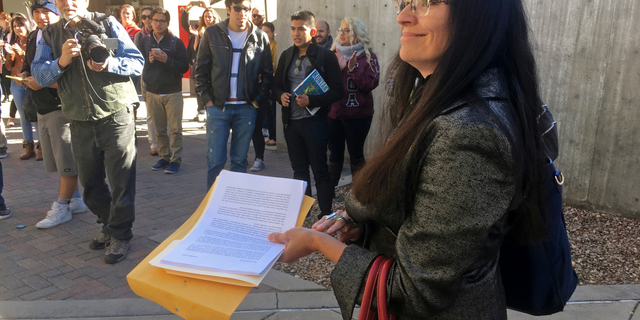 """FILE - In this Nov. 18, 2016 file photo, University of New Mexico Chicana and Chicano studies professor Irene Vasquez holds a letter with hundreds of signatures, asking school president Bob Frank to declare the campus a """"sanctuary university,"""" in Albuquerque, N.M. Vasquez and other Mexican American scholars from universities across the country are gathering in Albuquerque on Wednesday, April 3, 2019, for an annual four-day national conference amid uncertainty on immigration and ethnic studies battles on college campuses. (AP Photo/Russell Contreras, File)"""