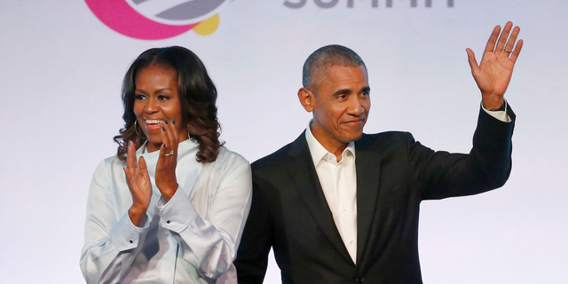 Former President Barack Obama, right, and former initial lady Michelle Obama seem during a Obama Foundation Summit in Chicago. The Obamas have denounced a line-up of projects in growth for Netflix, a year after a former boss and initial lady sealed a understanding with a streaming platform.