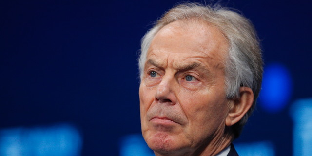 FILE - In this file photo dated Monday, April 30, 2018, former British Prime Minister Tony Blair listens during a discussion at the Milken Institute Global Conference, in Beverly Hills, Calif. USA. After leading Britain for a decade, believing society was becoming more tolerant, Tony Blair cannot comprehend how the national sport is being blighted by racism. (AP Photo/Jae C. Hong, File)