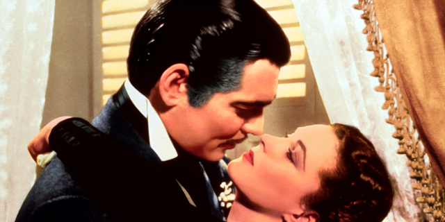 "This image released by Turner Classic Movies shows Clark Gable, left, and Vivien Leigh in a scene from ""Gone with the Wind."" On Thursday, the TCM Classic Film Festival will open its 10th annual edition in Los Angeles with ""When Harry Met Sally..."" To mark its anniversary, TCM will on Sunday again air ""Gone With the Wind,"" the film that it first transmitted on April 14, 1994."