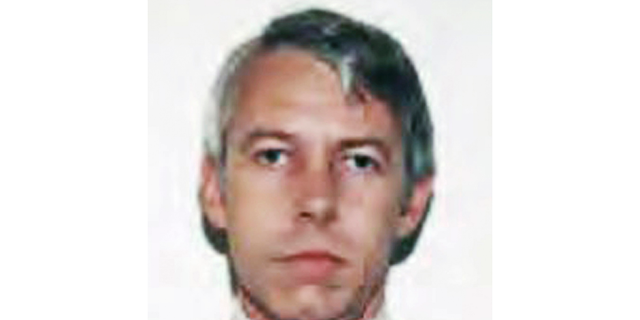 FILE – This undated file photo shows a photo of Dr. Richard Strauss, an Ohio State University team doctor employed by the school from 1978 until his 1998 retirement. A year after Ohio State announced an investigation into allegations of decades-old sexual misconduct by Strauss, a team doctor, his accusers are still waiting for the findings. Strauss killed himself in 2005. (Ohio State University via AP, File)