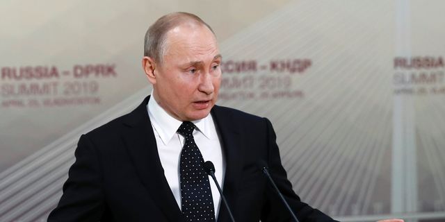 Russian President Vladimir Putin gestures while speaking to the media after his talks with North Korea's leader Kim Jong Un talk in Vladivostok, Russia, Thursday, April 25, 2019. President Vladimir Putin says after talks with North Korean leader Kim Jong Un that Pyongyang is ready to proceed toward denuclearization, but that it needs serious security guarantees to do so.