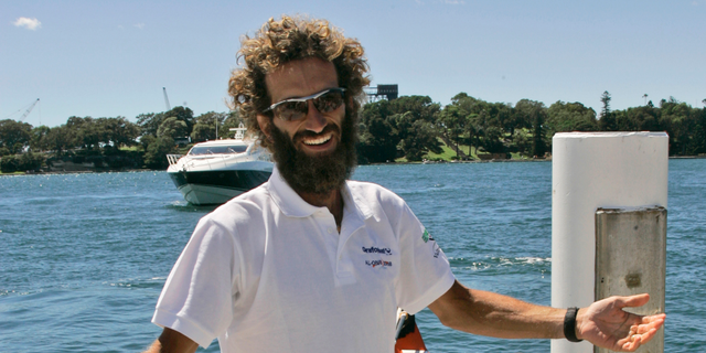 FILE - In this Sunday, Dec. 14, 2008 file photo, Italian solo rower Alex Bellini arrives at the Opera House in Sydney, Australia. Italian explorer Alex Bellini plans to travel down the world's 10 most polluted rivers on make-shift rafts, tracing the routes of plastics that pollute the world's oceans. Bellini said Thursday April 4, 2019 that he was inspired by a 2018 study by a German scientist that found 80% of plastic in the oceans arrives from just 10 rivers. (AP Photo/Rob Griffith, File)