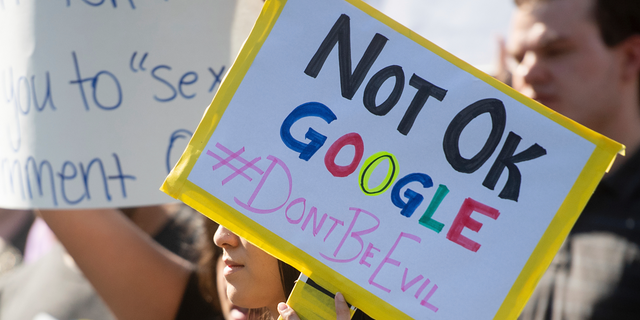 In this Nov. 1, 2018, file photo, workers protest against Google's handling of sexual misconduct allegations at the company's Mountain View, Calif., headquarters.(AP Photo/Noah Berger)