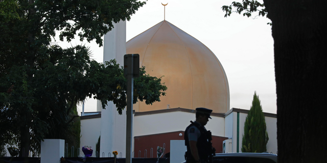 A police officer stands guard in front of the Al Noor mosque in Christchurch, New Zealand.