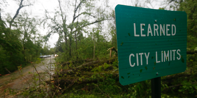 Fallen trees line the roads leading into the small community of Learned, Miss., Thursday, April 18, 2019. Several homes were damaged by fallen trees in the tree-lined community. Strong storms again roared across the South on Thursday, topping trees and leaving more than 100,000 people without power across Mississippi, Louisiana and Texas.