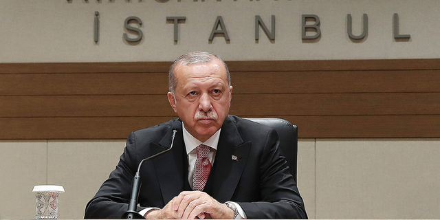"""Turkey's President Recep Tayyip Erdogan talks to members of the media regarding the local elections, in Istanbul, Monday, April 8, 2019, prior to his departure for Russia. Erdogan has defended his ruling party's move to demand a full recount of votes cast in mayoral elections in Istanbul, claiming that """"almost all"""" of the voting was marred by irregularities. Erdogan suffered a major setback in last week's local elections after the opposition took control of the capital Ankara and won a tight race for Istanbul. (Presidential Press Service via AP, Pool)"""