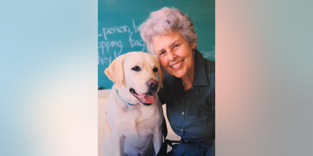 Judith Clark with one of the service dogs she has trained at the Bedford Hills Correctional Facility in Bedford, N.Y.