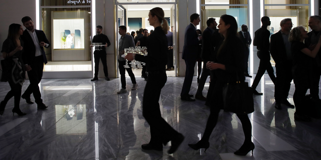 FILE- In this March 14, 2019, file photo people attend the opening of a Piaget store during the opening night of The Shops & Restaurants at Hudson Yards in New York. On Monday, April 1, the Commerce Department releases U.S. retail sales data for February. (AP Photo/Mark Lennihan, File)