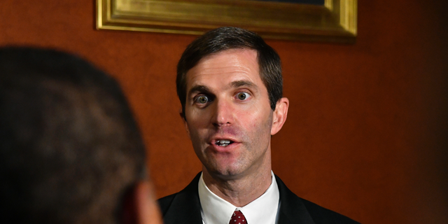FILE - In a Thursday, Sept. 20, 2018 file photo, Kentucky Attorney General Andy Beshear answers a reporters' question following his presentation to the Supreme Court at the Kentucky Capitol in Frankfort, Ky. says it disagrees with Kentucky's Democratic attorney general over the validity of a state law that could determine if the state's only abortion clinic stays open. The disagreement stems from a legal brief filed by Attorney General Beshear in support of the clinic, EMW Women's Surgical Center in Louisville.  (AP Photo/Timothy D. Easley, File)