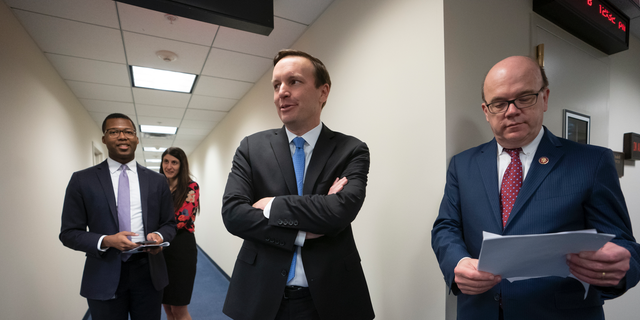 Sen. Chris Murphy, D-Conn., center, meets with House Rules Committee Chair James McGovern, D-Mass., right, after the House voted to end American involvement in the Yemen war, rebuffing the Trump administration's support for the Saudi-led military campaign, on Capitol Hill in Washington, Thursday, April 4, 2019, though President Trump is expected to veto it. It's the first time Congress has invoked the decades-old War Powers Resolution to try and stop a foreign conflict. (AP Photo/J. Scott Applewhite)