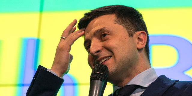 Ukrainian comedian Volodymyr Zelenskiy, reacts as he responds to a journalist question during a press conference, after the presidential elections in Kiev, Ukraine, Sunday, March. 31, 2019. (AP Photo/Emilio Morenatti)