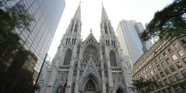 This Sunday, Aug. 30, 2015 file photo shows the newly renovated and cleaned facade of St. Patrick's Cathedral in New York. (AP Photo/Mary Altaffer, File)