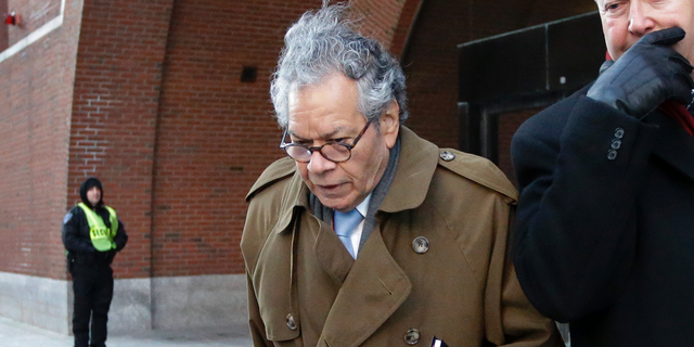 FILE - In this Jan. 30, 2019, file photo, Insys Therapeutics founder John Kapoor leaves federal court in Boston. He is one of four former company executives accused of scheming to bribe doctors into prescribing a powerful fentanyl painkiller. Lawyers are delivering their closing arguments Thursday, April 4, 2019, in the trial. (AP Photo/Steven Senne, File)