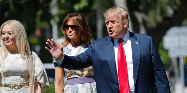 President Donald Trump, right, with first lady Melania Trump, center, and daughter Tiffany Trump, left, arrive for Easter services at Episcopal Church of Bethesda-by-the-Sea, Sunday, April 21, 2019, in Palm Beach, Fla. (AP Photo/Pablo Martinez Monsivais)
