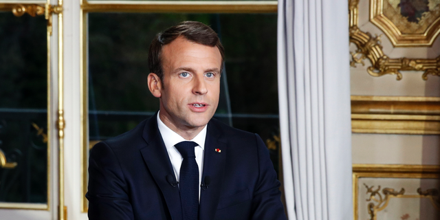 French President Emmanuel Macron sits at his desk after addressing the French nation following a massive fire at Notre Dame Cathedral, at Elysee Palace in Paris, on April 16, 2019.