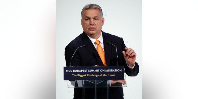 Hungarian Prime Minister Viktor Orban delivers his speech during the MCC Budapest Summit on Migration titled 'The Biggest Challenge of Our Time?' organized by the Mathias Corvinus Collegium (MCC) in Varkert Bazaar in Budapest, Hungary, Saturday, March 23, 2019. Hungary hosts the global migration conference attended by many experts, decision-makers and diplomats in the field from around the world from March 22 to 24. (Tibor Illyes/MTI via AP)