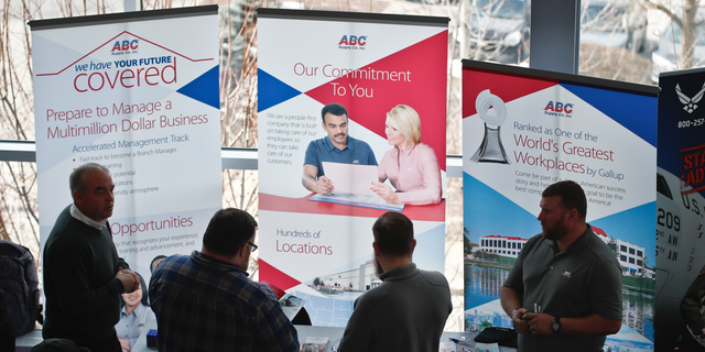 FILE- In this March 7, 2019, file photo visitors to the Pittsburgh veterans job fair meet with recruiters at Heinz Field in Pittsburgh. On Wednesday, April 3, payroll processor ADP reports how many jobs private employers added in March. (AP Photo/Keith Srakocic, File)