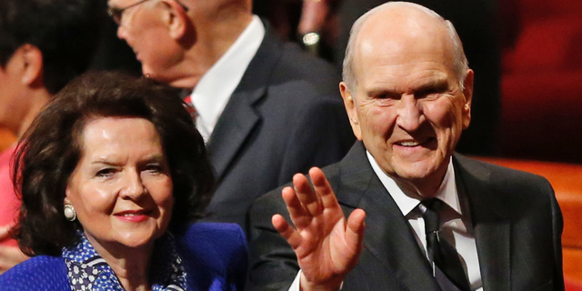 FILE - In this Oct. 6, 2018, file photo, President Russell M. Nelson and his wife, Wendy, wave as they leave the morning session of a twice-annual conference of The Church of Jesus Christ of Latter-day Saints in Salt Lake City. Nelson has generated buzz in his first year by becoming one of the most visible presidents in modern church history and implementing a number of changes. (AP Photo/Rick Bowmer, File)