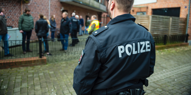 FILE -- A police officer attends a raid against fraud crime in Wriedel, Germany, Wednesday, March 27, 2019. New government statistics show overall crime in Germany, including violent offenses, dropped in 2018 while clearance rates continue to climb German Interior Minister Horst Seehofer said on Tuesday. (Philipp Schulze/dpa via AP, file)