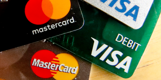 This Feb. 20, 2019, photo shows logos for credit cards in Zelienople, Pa. On Friday, April 5, the Federal Reserve releases its February report on consumer borrowing. (AP Photo/Keith Srakocic)