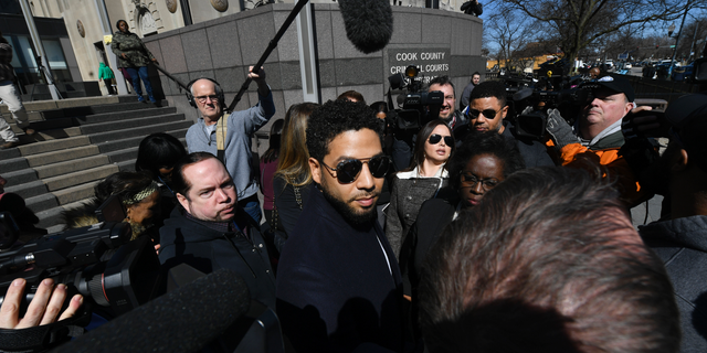Actor Jussie Smollett leaves Cook County Court after his charges were dropped, Tuesday, March 26, 2019, in Chicago.