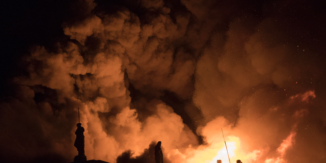 """FILE - In this Sept. 2, 2018 file photo, flames engulf the 200-year-old National Museum of Brazil, in Rio de Janeiro. Federal police say an air conditioning unit is the """"primary cause"""" of the fire that destroyed Brazil's National Museum in Rio de Janeiro. Fire experts have presented the conclusions of a seven-month investigation into the Sept. 2, 2018 fire, which began in the museum's auditorium and quickly spread to the rest of the building, destroying most of its 20 million artifacts. (AP Photo/Leo Correa, File)"""