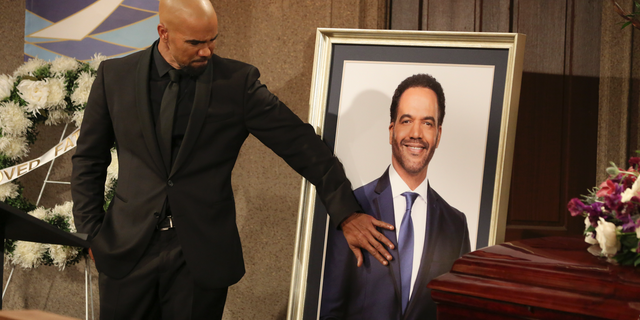 "Shemar Moore portraying Malcolm Winters during a funeral scene for the character Neil Winters, portrayed by the late actor Kristoff St. John, in ""The Young and the Restless."""