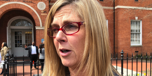 Anne Arundel County State's Attorney Anne Colt Leitess talks to reporters on Thursday, April, 4, 2019 in Annapolis, Md., after a judge delayed the trial of a man charged with killing five people at the Capital Gazette newsroom from June to November.  (AP Photo/Brian Witte)