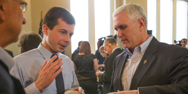 """Though Pete Buttigieg and Mike Pence worked together in Indiana, they have since had a public dispute, after Buttigieg criticized the vice president for his belief that homosexuality is a choice.<br data-cke-eol=""""1""""> (Robert Franklin/South Bend Tribune via AP)"""