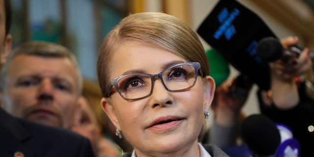 Former Ukrainian Prime Minister Yulia Tymoshenko, a candidate for the presidential elections, talks to the media after casting her ballot at a polling station during the presidential election in Kiev, Ukraine, Sunday, March 31, 2019. (AP Photo/Sergei Grits)