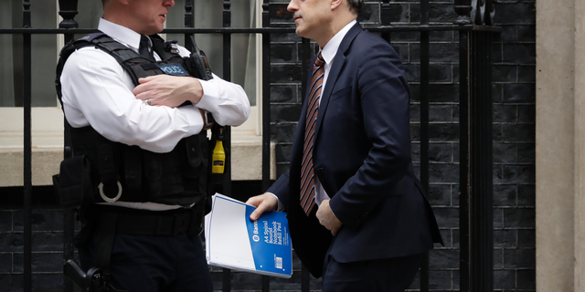 Britain's Chief Whip Julian Smith leaves 10 Downing Street, London, Thursday, March 28, 2019. The British government says it plans to hold a new Brexit debate in Parliament Friday, but hasn't confirmed whether it will call a third vote on its twice-rejected European Union divorce deal. (AP Photo/Matt Dunham)