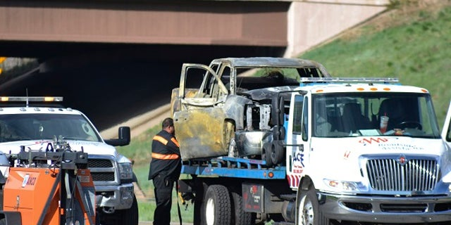 At least four people died Thursday when a semitrailer plowed into stationary traffic that resulted in explosions and flames on a Colorado freeway, authorities said.