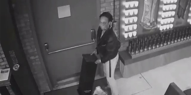 Image taken from surveillance video released by the NYPD showing a woman wanted for pilfering a donation box during a break-in at a parish church in New York last week.