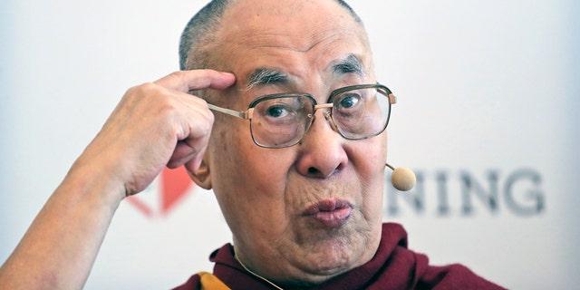 Tibetan spiritual leader the Dalai Lama speaks with reporters in New Delhi, India Thursday. (AP Photo/Manish Swarup)