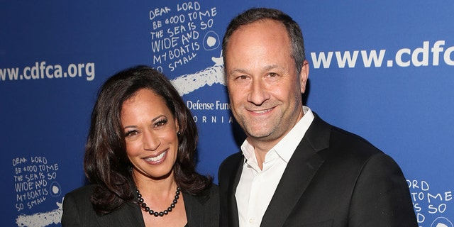Then-California Attorney General Kamala Harris and lawyer Douglas Emhoff (R) attend Children's Defense Fund - California Hosts 24th Annual Beat The Odds Awards at Book Bindery on December 4, 2014 in Culver City, California. (Photo by Jesse Grant/Getty Images for Children's Defense Fund)