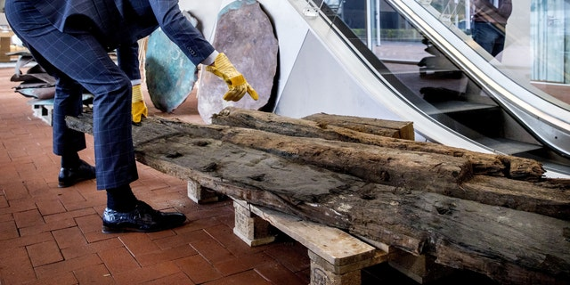 Wooden beams were also recovered from the shipwreck.