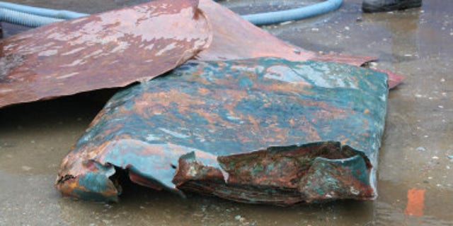 Copper plates discovered at the shipwreck site.