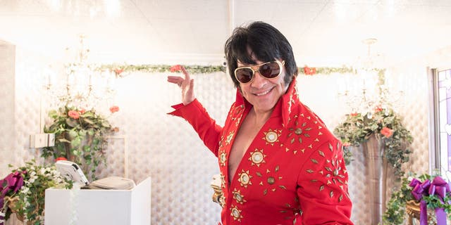 """A Little White Chapel offers on-site gown and tux rentals, florist services, songs from Elvis impersonators, and even a drive-thru """"Tunnel of Love"""" where couples can marry on-the-go."""