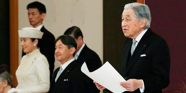 Japan's Emperor Akihito speaks during the ceremony of his abdication in front of other members of the royal families and top government officials at the Imperial Palace in Tokyo, Tuesday. The 85-year-old Akihito ends his three-decade reign on Tuesday as his son Crown Prince Naruhito, second from left, will ascend the Chrysanthemum throne on Wednesday.