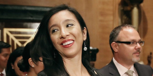FILE: Erica Lira Castro (C), wife of Julian Castro, attends his confirmation hearing before the Senate Banking, Housing and Urban Affairs Committee in the Dirksen Senate Office Building on Capitol Hill June 17, 2014 in Washington, DC. (Photo by Chip Somodevilla/Getty Images)
