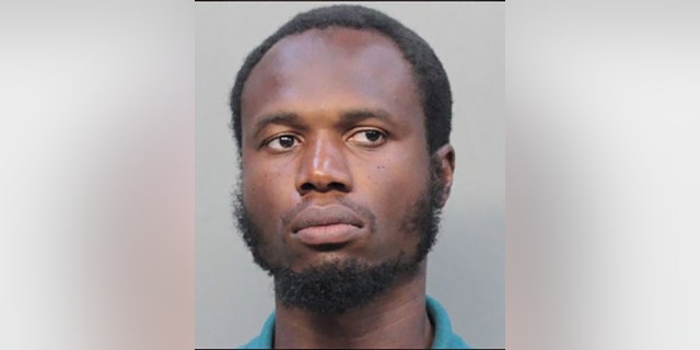 Holdson Marcelin, 38, allegedly smeared blood on an American flag at a Florida village hall.